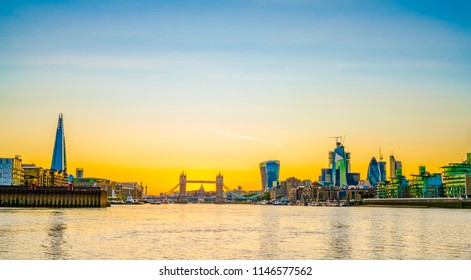 London skyline at sunset including Tower Bridge and skyscrapers at financial district