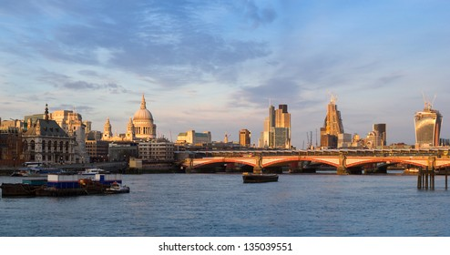 London skyline at sunset with St Paul's Cathedral and the financial district