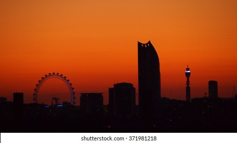 London skyline at sunset, viewed from rooftop bar
