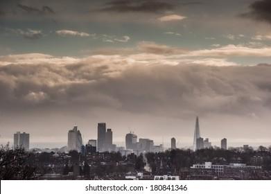 London skyline under dramatic dark clouds