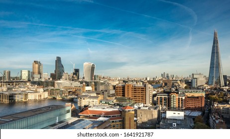 London Skyline. Wide angle panoramic view over the City of London, the River Thames and the iconic Shard skyscraper.