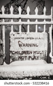 London Snow: A London warning street sign in the snow on The Embankment, City of Westminster, London, UK