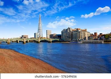 London Southwark bridge and the Shard on Thames river in UK