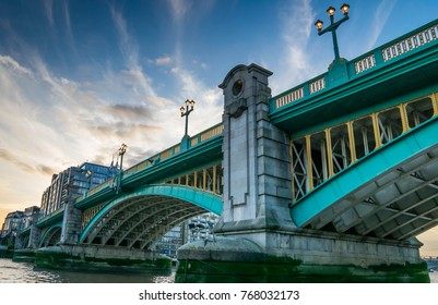 London Southwark bridge in Thames river UK.