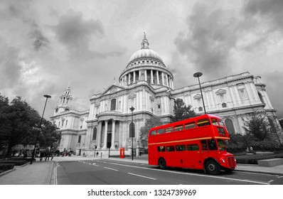 London St Paul's Cathedral and iconic Routemaster Bus present over dramatic sky.