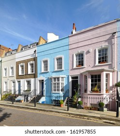 London street of colourful old terraced houses without parked cars