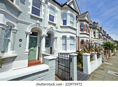 London street of early 20th century Edwardian terraced houses in a sunny day