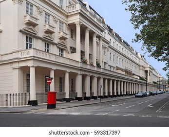 London street with long row of townhouses with columns