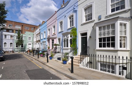 London street of old terraced houses without parked cars.