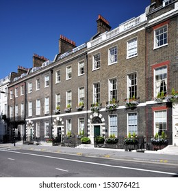 London street of preserved 18th century Georgian houses, without parked cars.
