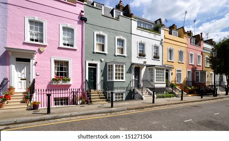 London street of terraced houses without parked cars.