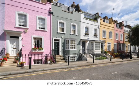 London street of terraced houses, without parked cars.