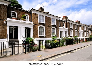 London street of typical small 19th century Victorian terraced houses, without parked cars
