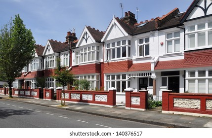 London street of typical small Edwardian terraced houses, without parked cars