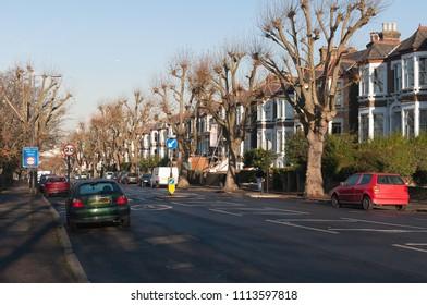 London suburb neighborhood urban brick house road trees