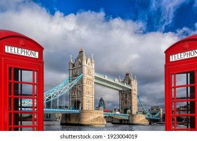 London symbols with Tower bridge against red phone boots in England, UK
