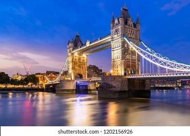 London Tower Bridge lifting up at Sunset dusk, London UK.