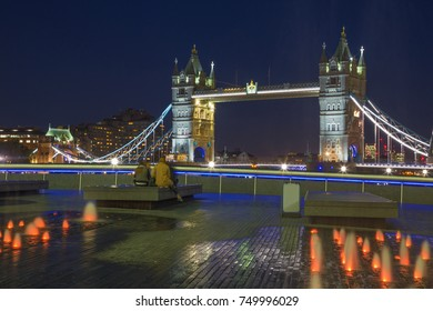 London - The Tower bridge, promenade and fountain at night.