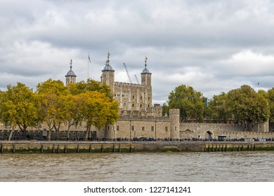 London Tower seen from the River Thames on a beautiful cloudy day. Her Majesty's Royal Palace and Fortress of the Tower of London