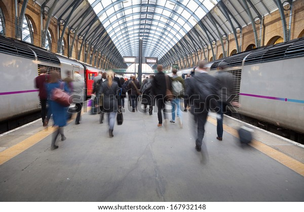 London Train Tube station Blur people movement in rush hour at King's Cross station, England, UK
