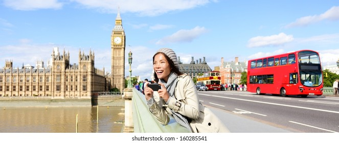 London travel banner with woman tourist, Big Ben and red double decker bus. Girl taking photo on Westminster Bridge with smartphone camera over River Thames, London, England, Great Britain, UK.