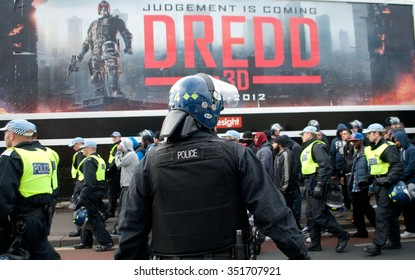London, UK. 01 Sept, 2012. Anti-Fascist protesters kettled under a Judge Dredd poster after trying to reach the English Defence League during their attempt rally outside Walthamstow Town Hall.