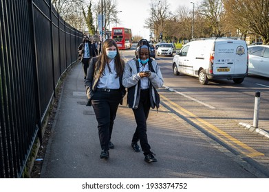 London. UK- 03.09.2021: Secondary school pupils going home after school on the second day of school re opening after Covid-19 lockdown with compulsory mask wearing and testing in place.