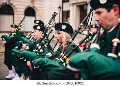 London / UK - 03/17/2017: People playing Bagpipes at St Patrick's Day Parade