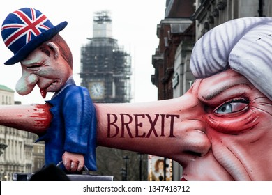"London, U.K., 03/23/2019, March for a ""People's Vote"" on Brexit. Cartoon model of Theresa May impaling a Brit with her nose, marker Brexit."