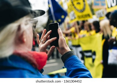 London / UK - 03/23/2019: taking pictures with a phone at Brexit March