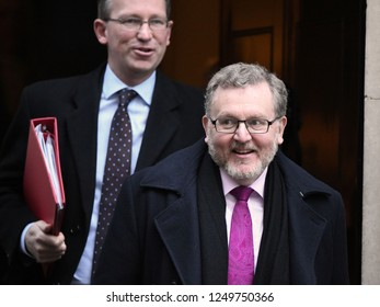 London, UK. 04 December, 2018. Jeremy Wright MP, and David Mundell MP, Secretary of State for Scotland, leave the weekly Cabinet Meeting, 10 Downing Street.