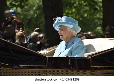 London, UK- 06/09/18: Queen Elizabeth II rides to the Trooping of the Colour in a horse drawn carriage wearing a pale blue outfit