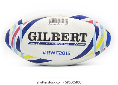 LONDON , UK - 07.03.2017 - Close up of a mini official replica rugby ball by Gilbert for the Rugby World Cup England 2015 isolated on white background, promo product shot.