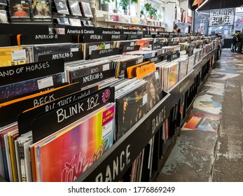 London. UK- 07.12.2020: a large shop on Brick Lane specialising in vinyl records on long play and singles, books and cassette tapes, all outdated forms of music recordings and materials.
