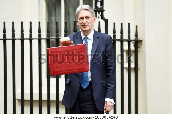 London, UK. 08 March, 2017. Chancellor departs No 11 with red box.