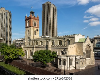 LONDON , UK - 08/25/2017:  View of St Giles' Cripplegate Church in the Barbican Centre with one of the Barbican Residential Tower Blocks in the background