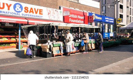 London / UK - 09 09 2016: Walthamstow High Street is captured street-level with discount pound shops and market vendors