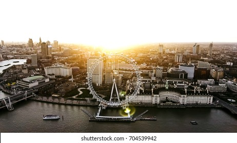 LONDON, UK - 09 APRIL 2017 : Aerial View of the Iconic Landmark Riverside London Eye Observation Wheel at Dawn Time with Sunrise on 09 April 2017 in Central City of London