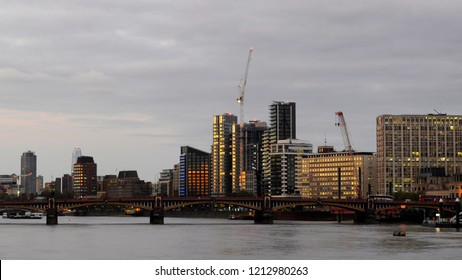 London, UK / UK - 10/19/2018: Vauxhall Bridge across the River Thames with Camelford House, Tintagel House and Peninsula Heights in background.