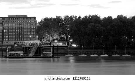 London, UK / UK - 10/19/2018: Westminster Boating Base jetty and moored dinghies with Raleigh House in background, Pimlico.
