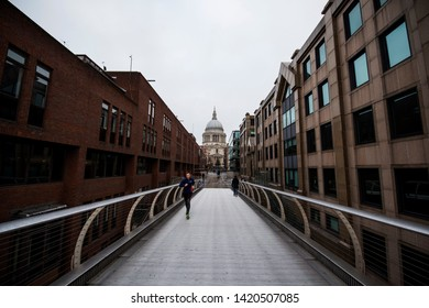 London, UK - 10th Dec 2017 - St. Pauls cathedral and Millennium Bridge, London, UK