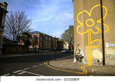 "LONDON, UK - 10TH NOVEMBER 2007: Banksy's ""Sunflower"" graffiti located in Bethnal Green in London."