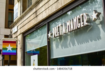 London, UK - 11 August 2019: Facade of Pret A Manger store with rainbow colored logo in celebration of London Pride Week. Pret is an international sandwich shop chain based in the UK.