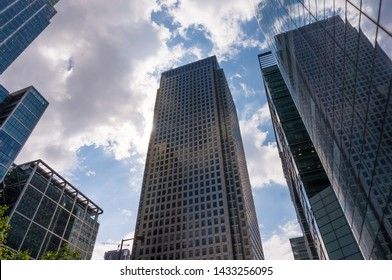 London, UK - 11 June 2019: Canary Wharf financial district. London Skyline modern architecture. Futuristic glass and concrete buildings. Looking up at futuristic London skyscrapers