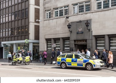 LONDON, UK - 11 MAY 2017:  Police car and motorcycle outside Bishopsgate police station