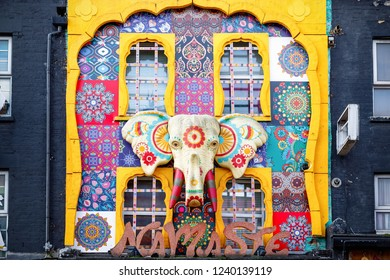 London, UK - 11 November, 2018 - Giant elephant head decorated on the facade of an India clothing shop at Camden Market