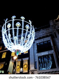 London, UK - 11/28/16: 2016 Christmas lights on intersection of Old and New Bond Street.