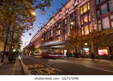 LONDON, UK - 11TH NOVEMBER 2018: Views along Oxford Street around Selfridges around Christmas time. Colourful Christmas decorations and lights. People can be seen.