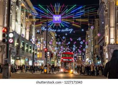 LONDON, UK - 11TH NOVEMBER 2018: Views along Oxford Street with colourful Christmas decorations and lights. Lots of people can be seen.
