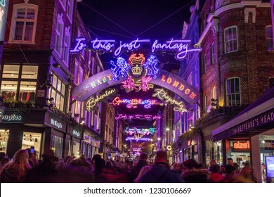 LONDON, UK - 11TH NOVEMBER 2018: Carnaby Street Christmas decorations in 2018. In a Bohemian Rhapsody theme. Lots of people can be seen.